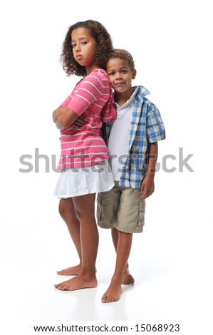 Brother and sister smiling isolated on white