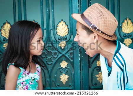 Brother and sister start a fight with each other - stock photo