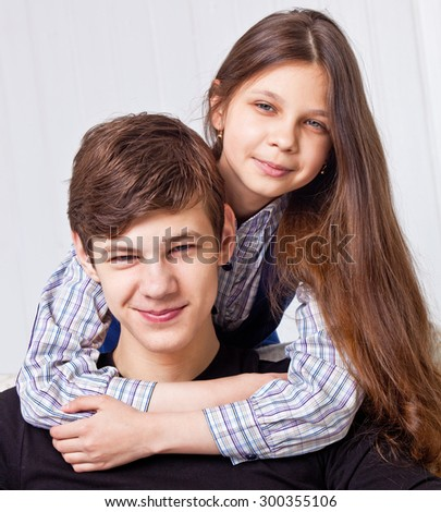 Brother and sister studio portrait - stock photo