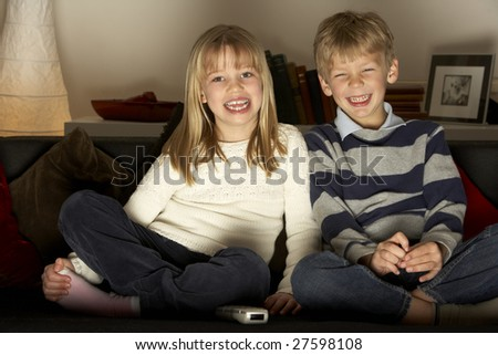 Brother And Sister Watching Television - stock photo