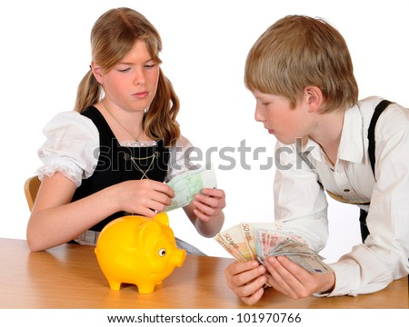 Brother and sister with piggy bank - stock photo