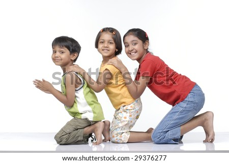 brother and two sisters enjoying together - stock photo