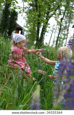 Brother giving flower for his little sister - stock photo