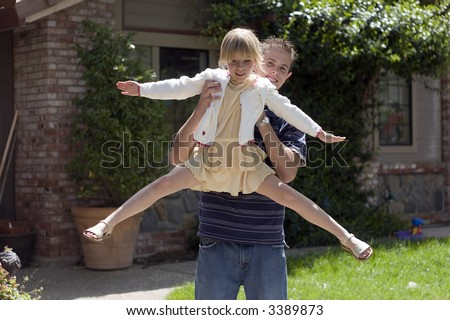Brother Holding Sister Up - stock photo