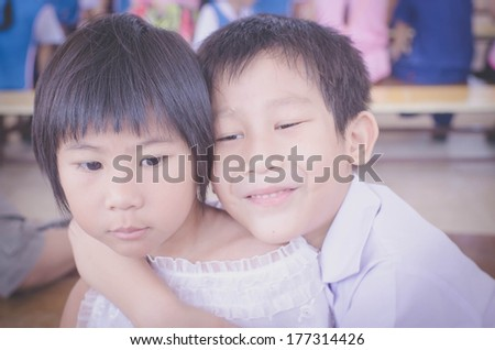 Brother hug his sister with love - stock photo