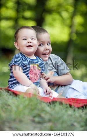 Brother hugging his sister while their father shot them - stock photo