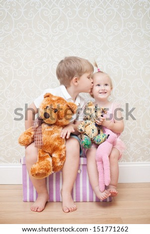 brother kissing little sister - stock photo