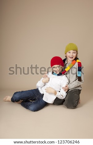Brother with caps and scarf - stock photo