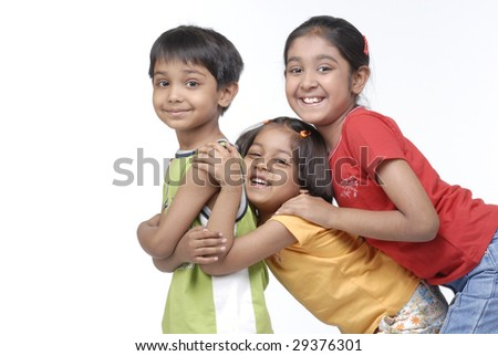 brother with two sisters hugging friendly - stock photo