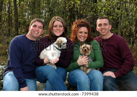 brothers and sisters with dogs - stock photo