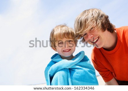 Brothers at the beach - stock photo