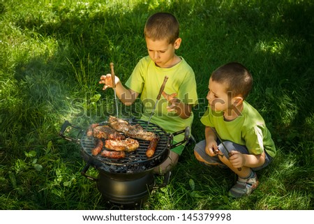 Brothers having a barbecue party