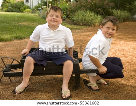 Brothers having fun outdoors early summer - stock photo