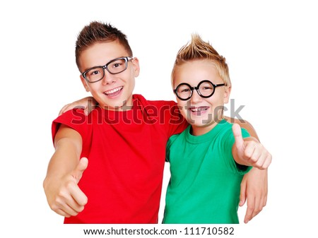Brothers in glasses showing thumbs up - stock photo