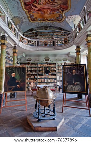 BROUMOV, CZECH REPUBLIC - AUGUST 1: Old library inside the Monastery on August 1, 2010. Visitors can see the unique replica of the Tourine canvas from the year 1651 inside. - stock photo