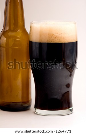 Brown Ale in Pint Glass with Empty Beer Bottle