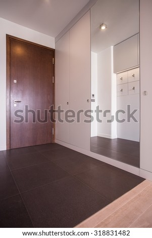 Brown and beige anteroom in luxury house