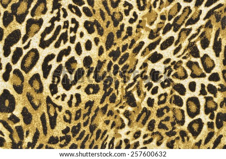 Brown and black leopard pattern. Spotted animal print as background. - stock photo