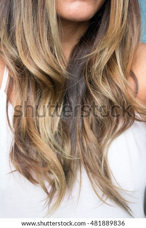 Brown and Blonde Highlights Woman Hair.