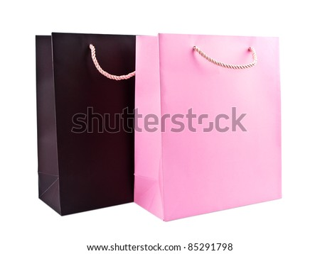 Brown and pink gift bags on white background - stock photo