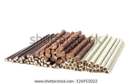 Brown and white filled chocolate sticks isolated over white