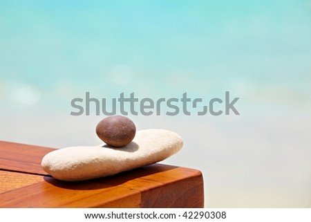 Brown and  white stones are on a beach table - stock photo
