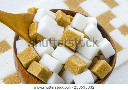 Brown and white sugar cubes - stock photo
