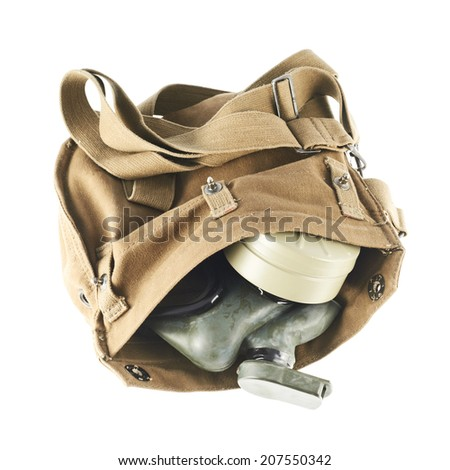 Brown army shoulder bag with the gas mask inside isolated over the white background - stock photo