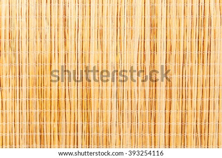 Brown bamboo straw mat. Macro. Photo can be used as a whole background. - stock photo