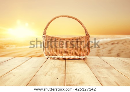 brown basket and sea and beach  - stock photo