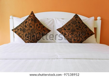 Brown bedroom in a modern house - home interiors. - stock photo