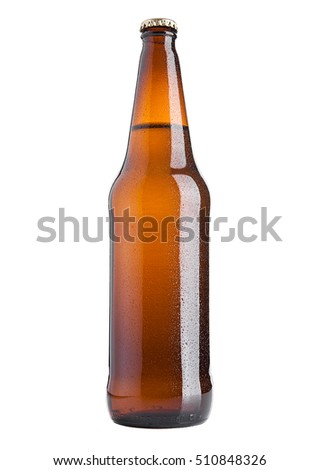 Brown beer bottle cold with frost on white background isolated