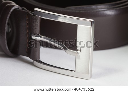 Brown belt buckle closeup