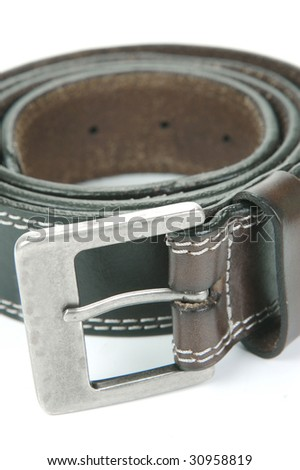 Brown belts isolated against a white background