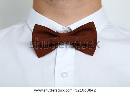 Brown bow tie on a white shirt - stock photo