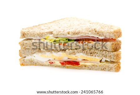 Brown bread Sandwich with ham, cheese, turkey, egg and salad. On white background. - stock photo
