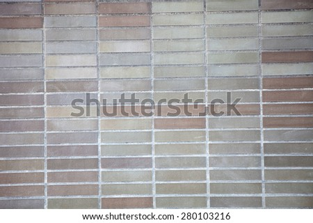 Brown brick wall as exterior trim option. - stock photo