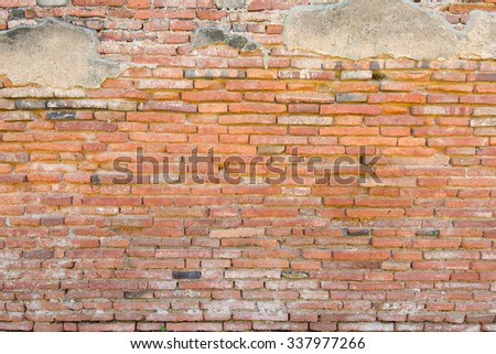 Brown brick wall in an old contemporary temple in Thailand - stock photo