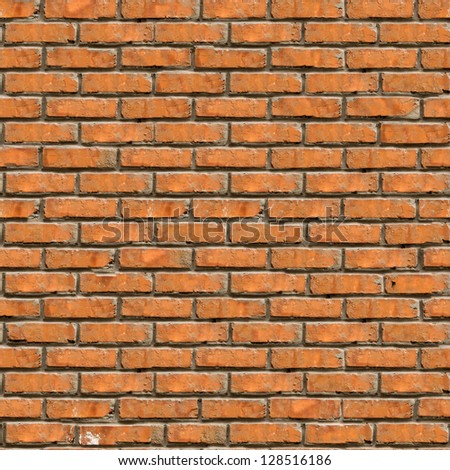 Brown Brick Wall Texture. Grunge Seamless Tileable Texture. - stock photo