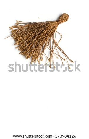 Brown brush of threads for decoration. Photo.
