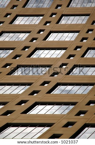 brown building detail with windows - stock photo