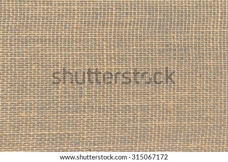 Brown burlap, hessian or jute loosely woven on gray linoleum, texture background, copy space - stock photo