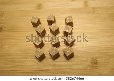 Brown cane sugar on wooden background