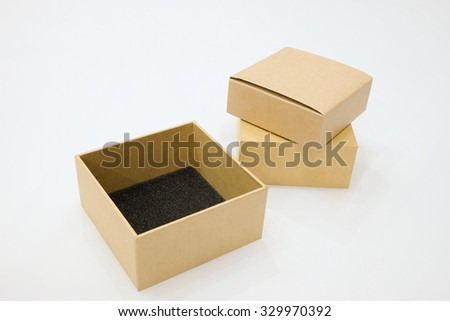 Brown cardboard box as a parcel - isolated on white