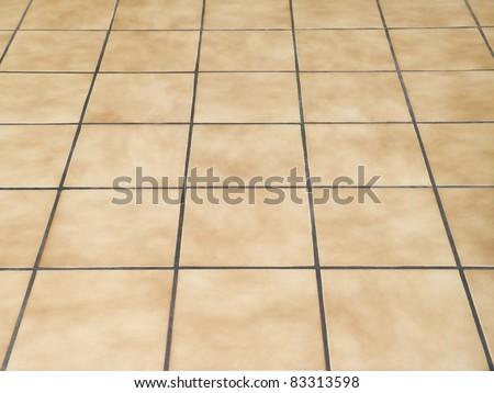 Brown ceramic floor tiles closeup texture - stock photo