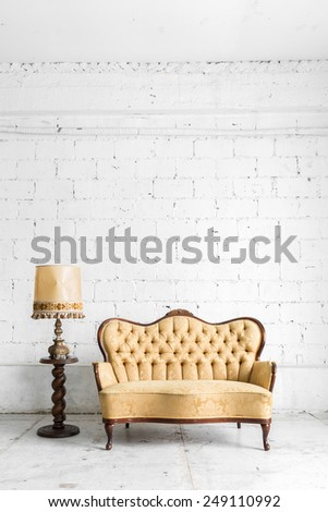 Brown Classical style Armchair sofa couch in vintage room with desk lamp - stock photo