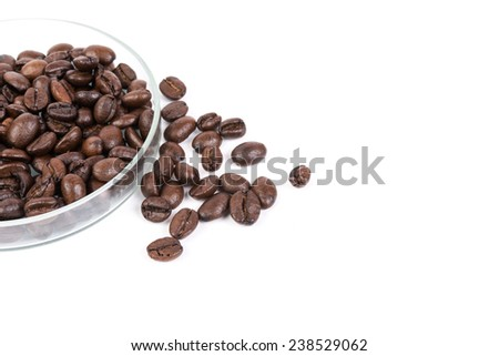 Brown coffee beans isolated on white background