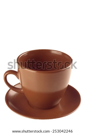 Brown coffee cup and saucer on white background with clipping path - stock photo