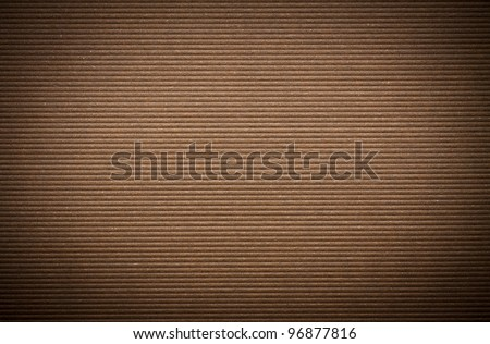 Brown corrugated paper cardboard texture background. - stock photo