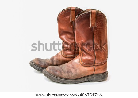 brown cowboy boot on white background - stock photo